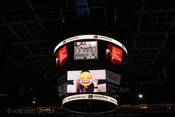 Video plays on Flames Energy Board at the WHL Calgary Hitmen hockey game in support of youth mental health