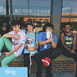 img des: Four friends sitting together