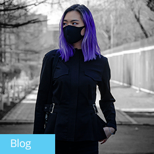 img text: Blog img des: Person wearing mask, standing outside