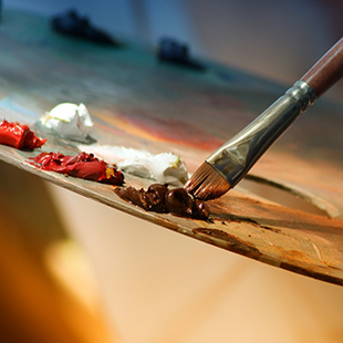 the art of regret blog post, paint brush dipped in brown paint