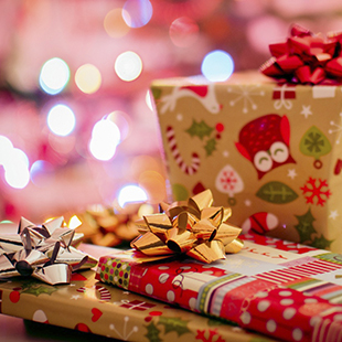 wrapped presents with lights in the background