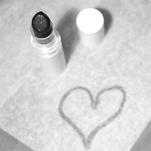 image of lipstick and heart drawn in lipstick